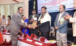 Felicitation of Honorary Chair Dr. Krishnaraj Madhavjee Sunjiv Soyjaudh by Sri. B V Srinivasa Gupta, Vice-President, GSSS(R)